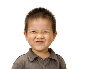 Cute preschool-aged boy with a silly grin on his face