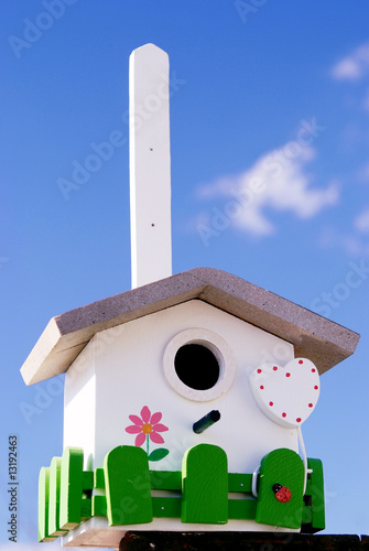 Hand made creative nestling box on sky blue background