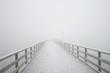 Leinwandbild Motiv Steg im Nebel