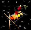 assorted sushi plate with red rose