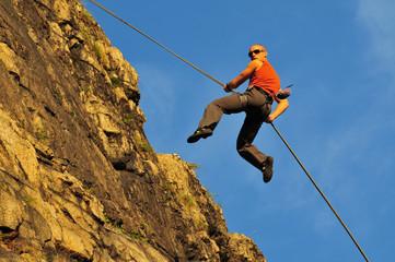 rock climber jumping