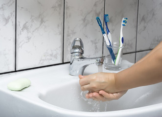 Woman wash her hands
