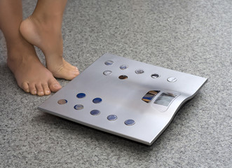 feet near bathroom scale