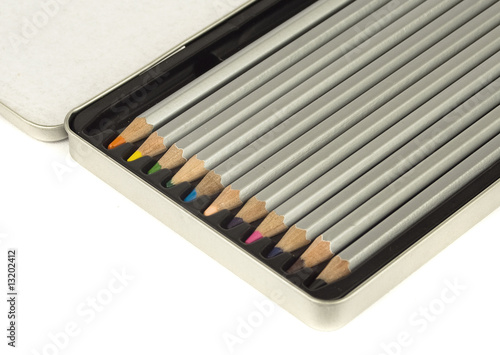 colored pencils in metal box