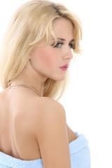 Beautiful blonde lady in a blue towel
