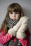 little cute upset  girl with scarf poster