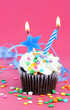 Birthday party chocolate cupcake with candle and star lit.  Copy