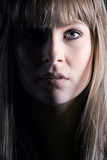 Close Up Shot of a Pretty Brunette with Fringe poster