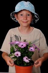 Young Boy Pot Flowers Osteospermum