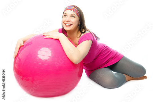 Tuinposter Gymnastiek happy pregnant woman with a fitness ball