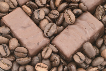 Chocolate on the coffee beans background