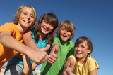 group of happy tweens at summer camp thumbs up