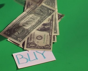 buy card on table and falling dollars