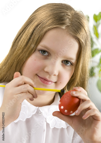 Girl painting easter egg