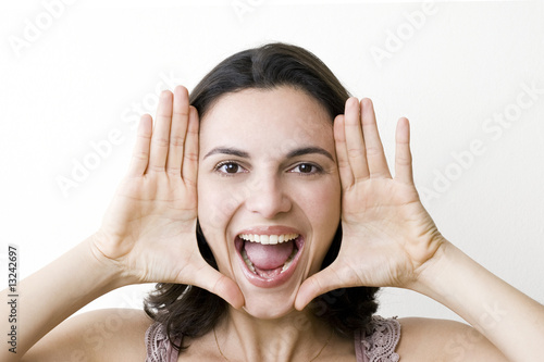 Young woman frame her face with palms
