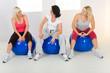 Elder women sitting on fitness balls