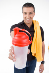 front view of smiling man offering water bottle