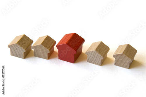 "Five wooden houses  from ""Monopoly"" on white background"