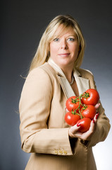 attractive blond woman with bunch tomatoes fresh  for healthy li