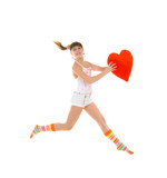 Happy girl is jumping with heart over white background