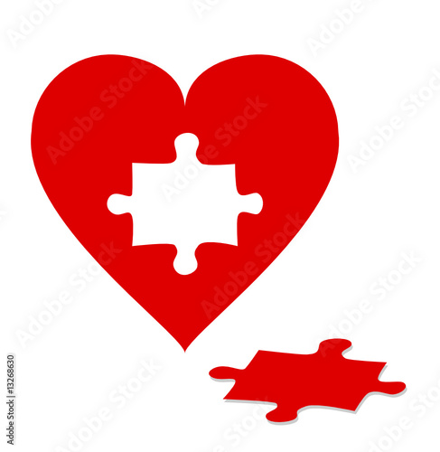 Jigsaw puzzle with red heart isolated on white background