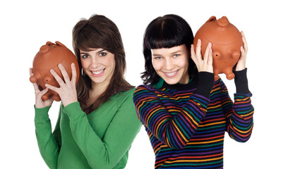 Two attractive girls with money box