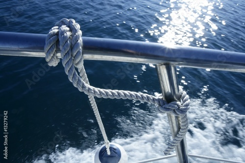 Leinwanddruck Bild Marine fender knot around boat lee