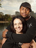 Attractive young interracial couple poster