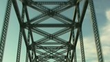 Traveling on Bridge with Steel Beams Overhead poster