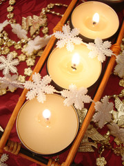 row of candles with decoration