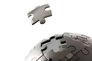 Puzzle globe with floating piece
