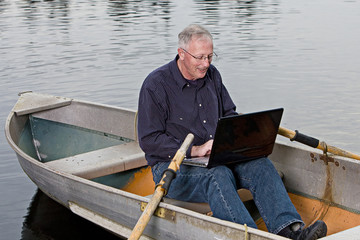 Mature Man working on computer outside