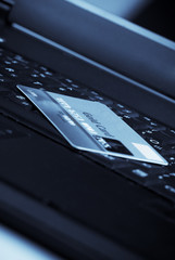Macro close-up of credit card on laptop's keyboard
