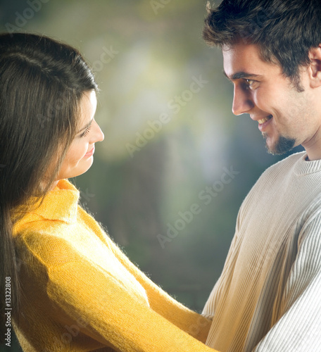 Playful young happy smiling couple embracing, outdoors