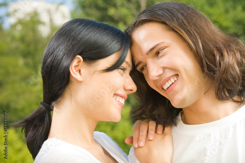 Young happy attractive couple relaxing together, outdoors