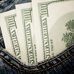 Close-up of dollars in pocket of jeans, shopping background