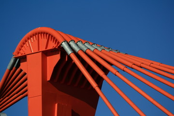 orange pylon of bridge