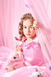 Beautiful little girl in pink barbie style
