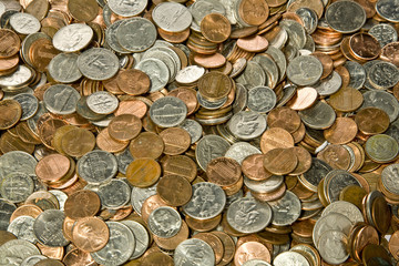 Pile of loose American coins useful as a background.