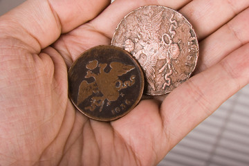 old coins in hand