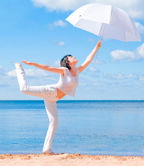 Girl in white with umbrella