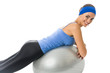 Young happy woman with fitness ball, isolated on white