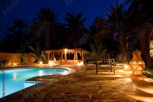 Leinwanddruck Bild Arab hotel pool evening