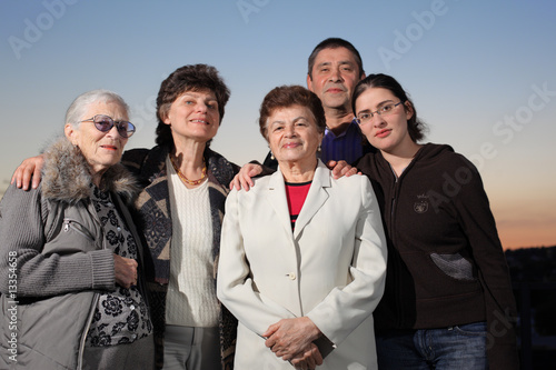 Portrait of a happy family together outdoors
