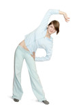 Smiling girl doing aerobics  over white background