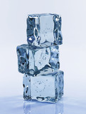three ice cubes on blue background