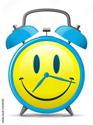 Classic alarm clock with smiley face