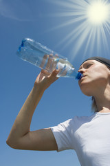 sporty woman have water from bottle