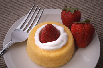 Strawberrie Short Cake with strawberries on side and Fork