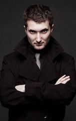 portrait of stern man in black coat